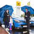 Alison Reid and her daughter with Paul Cameron, the General Manager of the Grangemouth Renault/Dacia, receiving her new Clio Hatchback.