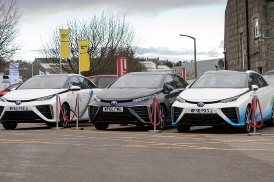 Three Toyota Mirai lined up outside Aberdeen Toyota