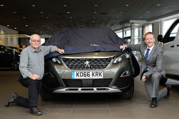 Alex Munro from the Isle of Lewis collects Peugeot 3008 prize from Inverness Peugeot