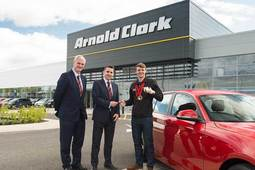 Arnold Clark supports Olympic swimmer Ross Murdoch