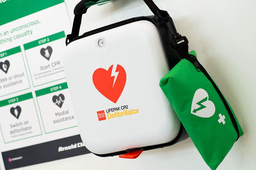 A defibrillator within an Arnold Clark branch.