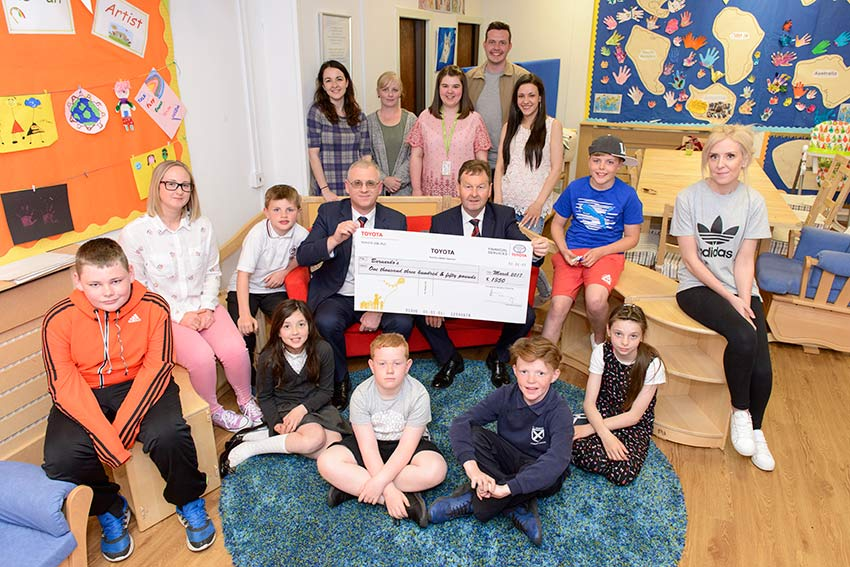 Staff presenting the cheque to the group at Barnardos Nurture Service Inverclyde.