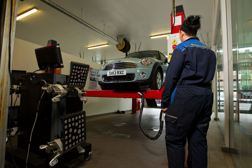 Wheel alignment is completed using the machine on the left here, and must be done by an experienced mechanic