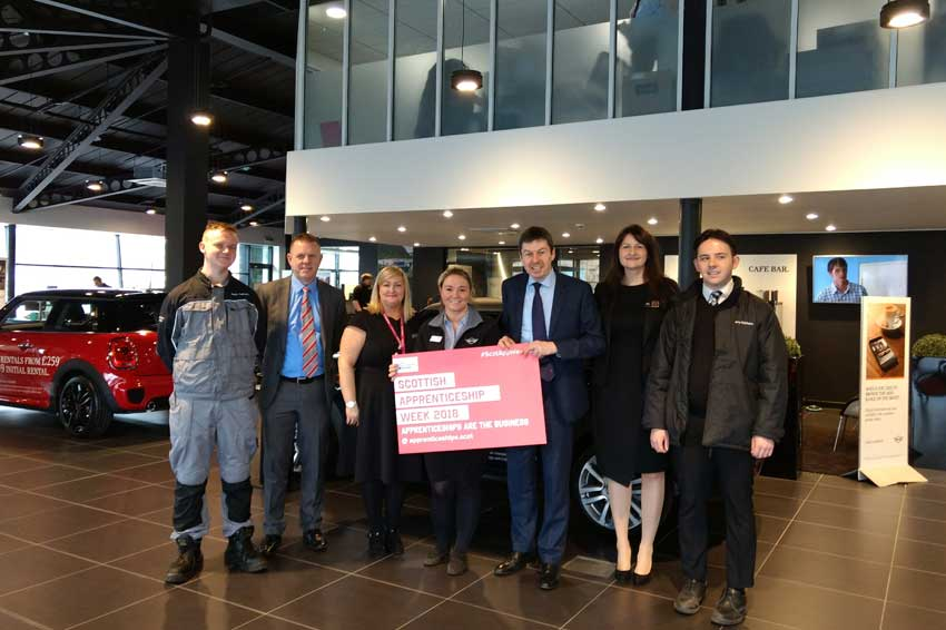 Ken MacIntosh MSP with apprentices and staff at Giffnock MINI