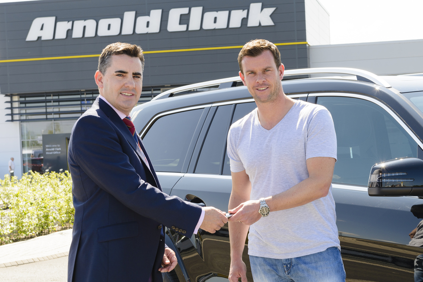 Russell Borrie, Group Franchise Director, presented Leon Smith with the keys to his new car
