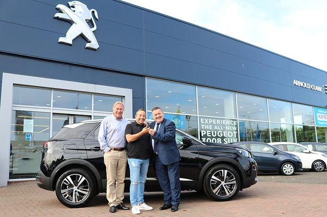 Scott collecting his car at Arnold Clark Glasgow Peugeot