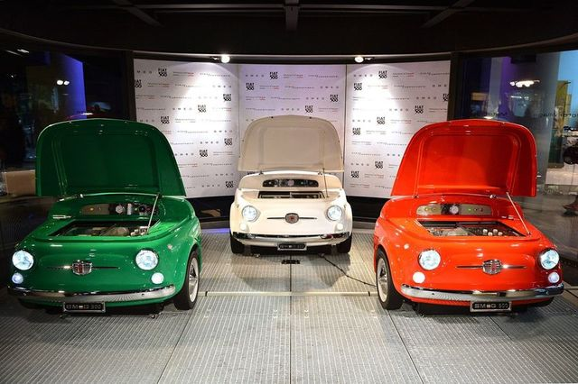 The fridge comes in a choice of white, green or red and has original design features such as working headlights. Image: Fiat