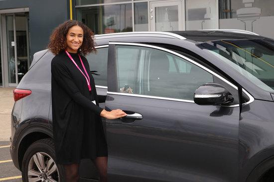 Anastasia with her Kia Sportage