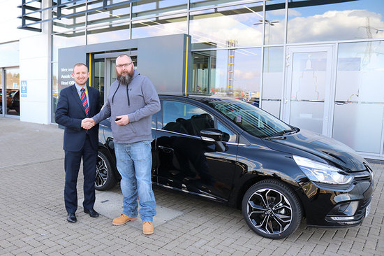 Andrew MacPhee collecting his new Renault Clio.