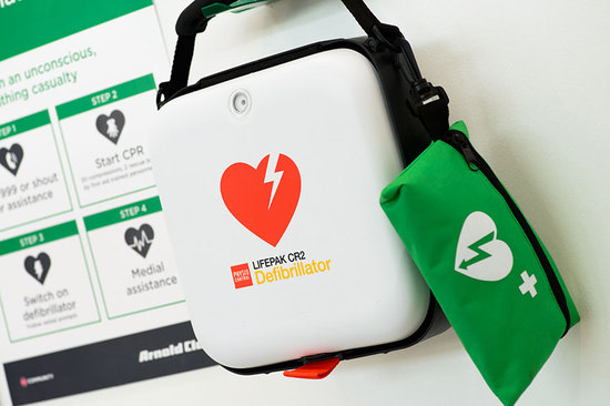 A defibrillator within an Arnold Clark branch.