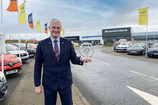 Eddie Hawthorne received his Motor Trader award at Arnold Clark's Hillington head office.