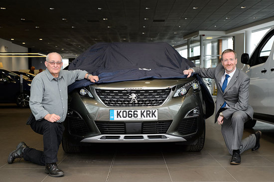 Alex Munro collected his prize from Inverness Peugeot last week