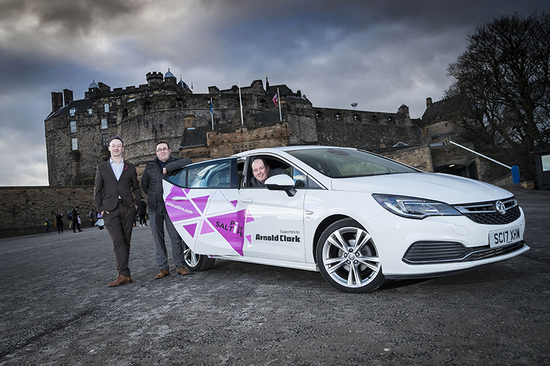 Stuart with the Vauxhall Astra and some of his colleagues from the charity