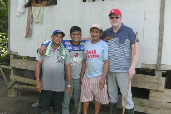 Karl worked with Edwardo and his son to help them harvest rice crops and rebuild their home