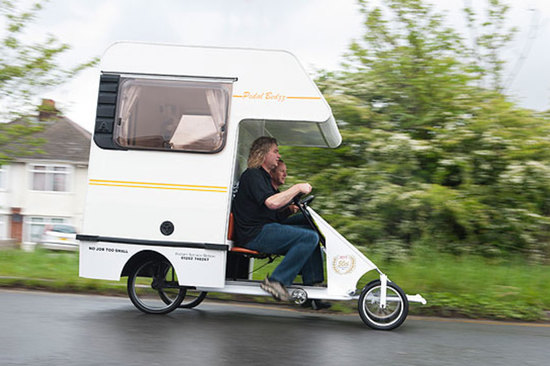 The inventor made the cramper van out of an old Bedford Bambi caravan, which he cut down to size and fitted on top of a Butlins-style pedal cart. Image: BNPS